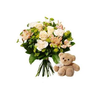 Bukett med nejlikor, rosor, alstromeria och gröntnejlikor, rosor, alstromeria och grönt och en liten nalle. Finns hos Interflora.