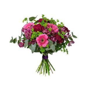 Bukett med blommor i lila och rosa; nejlikor, germini och alstroemeria. Skicka buketten med ett blommogram från Interflora!