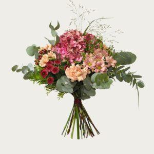 Interfloras unika bukett för september. En kombination av hortensia, santini och nejlika. Grymt tjusig! Beställ blommorna online hos Interflora.